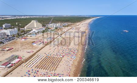 Aerial. Numerous tourists on the Monte Gordo beach. View from the sky.