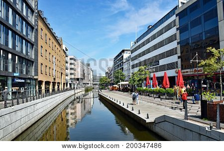 Aarhus, Denmark - July 20, 2017: Promenade along the river Aarhus A in the city center of the town of Aarhus in Denmark.