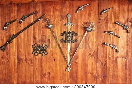 Collection of old antique historical traditional Spanish weapons on display