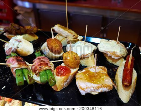 Typical traditional Spanish Tapas served on a tray in an authentic restaurant