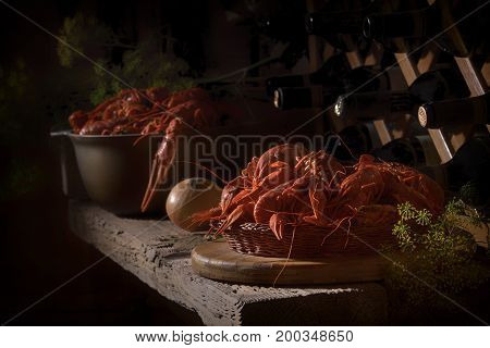 The rustic style. A big pot of crayfish stands on wooden shelf in wine cellar.