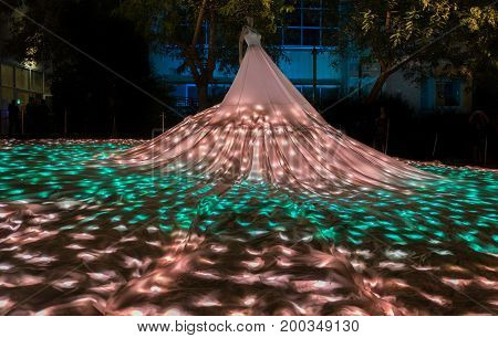 BEER SHEVA, ISRAEL - AUGUST 09, 2017: glowed bride's dress art installation at annual light show