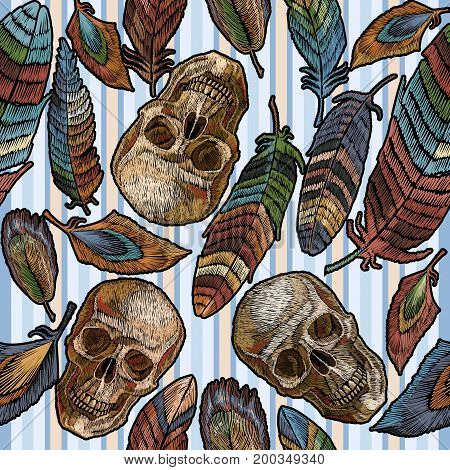 Color feathers and indian skull boho embroidery seamless pattern in blue stripes. Beautiful feathers of tropical birds and human skull classic embroidery seamless pattern