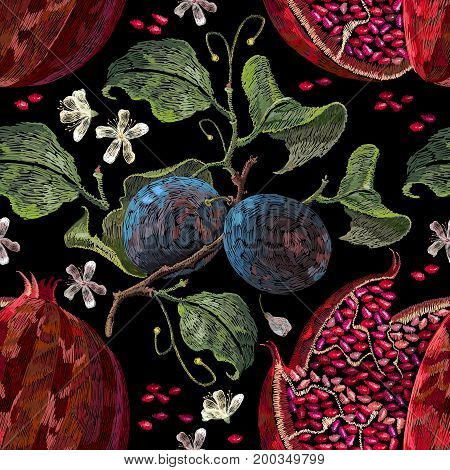 Embroidery pomegranate and blossoming plum seamless pattern. Embroidery ripened red pomegranate and white flowers of cherry and plum template clothes t-shirt design textile design
