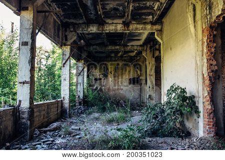 Abandoned factory building, inside large workshop, abandoned warehouse