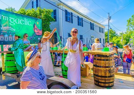 People walking in the 39th Annual Provincetown Carnival Gods and Goddess Parade on Commercial Street in Provincetown, Massachusetts August 17, 2017 USA