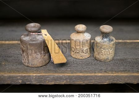 Old Weights  On Work Bench - Vintage Kg Weights On Wooden Background
