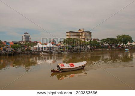 Traditional Boat On Sarawak River From Waterfront In Kuching City. Sarawak. Borneo. Malaysia