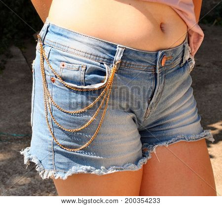 trousers with chain jewellery female torso of a young adult woman