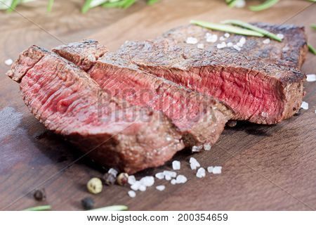 medium rare sliced steak with salt and pepper