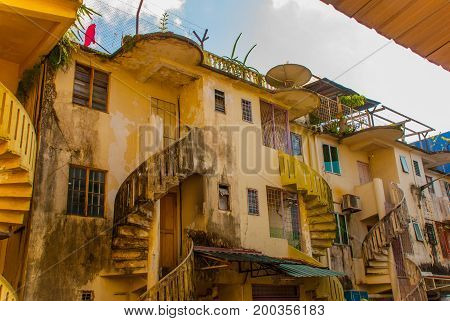 Strange And Ancient, Old Building With A Spiral Staircase. Sarawak Borneo Malaysia Kuching