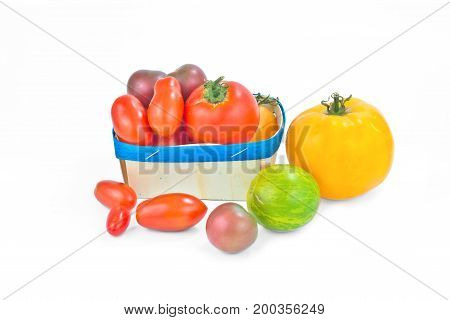 Assortment organic vegetable colorful tomatoes isolated on white background