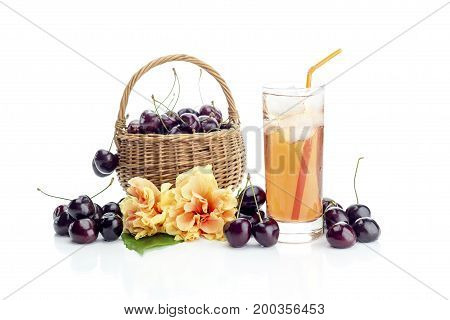 Basket with cherries and juice on a white background closeup