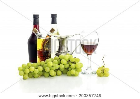 Summer fruit and wine on a white background closeup