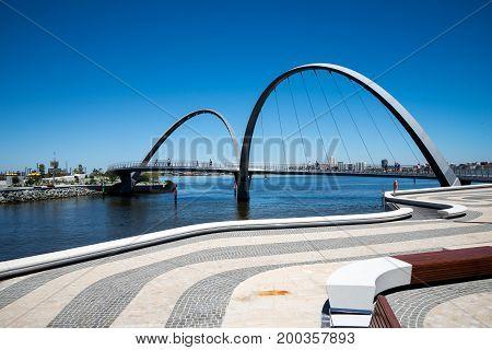 People walking across Elizabeth Quay Bridge in Perth City Western Australia