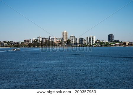 South Perth view from Elizabeth Quay Bridge with ferry crossing Swan River towards Mend Street jetty Western Australia poster