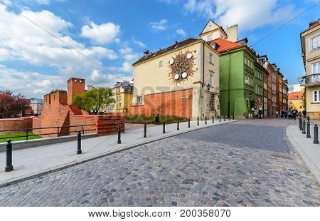 Ancient town clock in the Warsaw street. Poland. Europe.