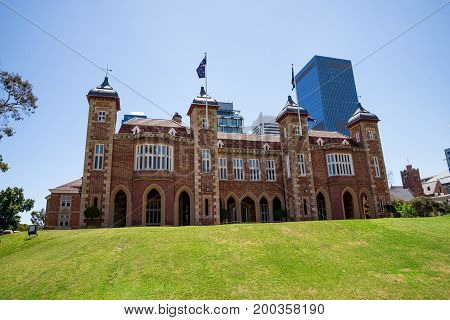 A view of Government House with Perth City Central Business district buildings on background Western Australia