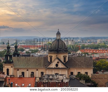 Roofs of the houses and the church in evening time. Krakow. Poland