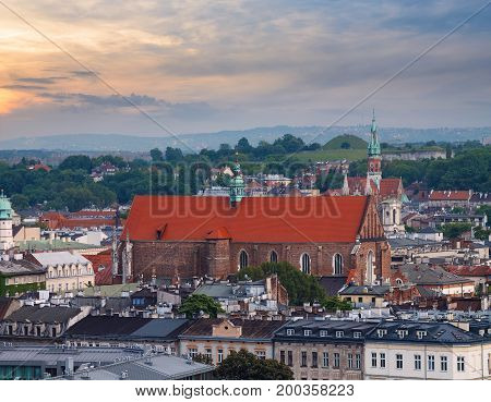 View on the roofs of the houses and the church in evening time. Krakow. Poland