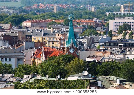 View on the roofs and town clock. Krakow. Poland