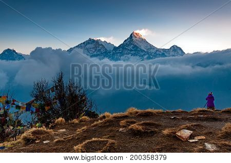 Unidentified Person Taking Photo Of Annapurna Mountain Range At Poon Hill View Point In Nepal. Poon