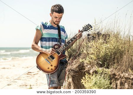 The Young Man On The Field, The Musician With The Guitar And Amp, The Concept Of Music And Art