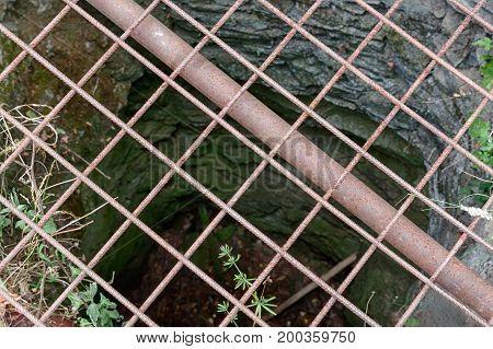 Steel Grid On The Castle Well In Castle Ruins Of Tempelstein In Czech Republic.