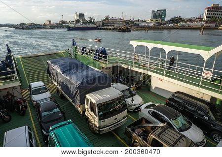 Labuan,Malaysia-July 23,2017:View of vehicles on the ferry that use a ferry to cross the South China Sea from Labuan island to Sabah.This is the economical transportation to the Labuan Pearl of Borneo
