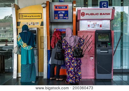 Labuan,Malaysia-July 24,2017:People using the ATM (Automatic Teller Machine) to withdraw & transfer money at Labuan Financial Park Complex in Labuan island,Malaysia.