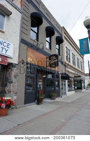 CADILLAC, MICHIGAN / UNITED STATES - MAY 31, 2017: One may drink beer at the Clam Lake Beer Company in Downtown Cadillac.
