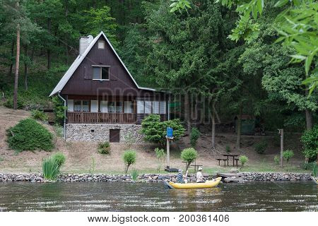 Cottage on the bank of the river Jihlava Czech Republic in the summer day.