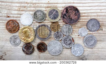 image of a various coins on wood background