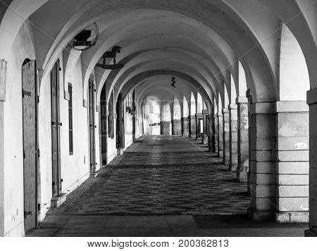Old historical arcade in Loretanska Street near Prague Castle, Prague, Czech Republic. Black and white image