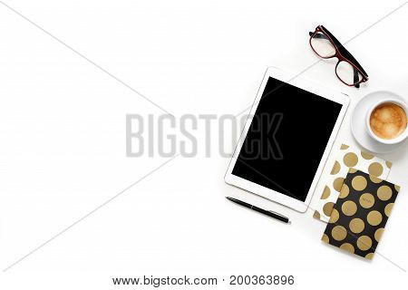 Flat Lay Photo Of Office White Desk With Tablet, Cup Of Coffee And Gold Notebook Copy Space Backgrou