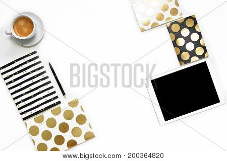 Flat Lay Photo Of Minimalistic White Office Desk With Tablet, Cup Coffee And Stylish Gold Notebook C
