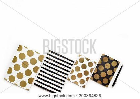 Flat Lay Photo Of Minimalistic White Office Desk With Stylish Gold Notebooks Copy Space Background