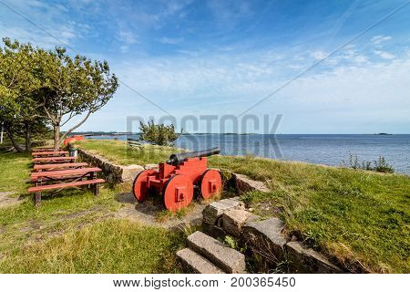 Cannons standing on Odderoya, Kristiansand, Norway. Used to defend Kristiansand. View to the sea, blue sky