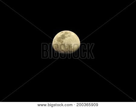 waning gibbous moon at clean black sky