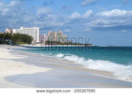 The view of Paradise Island beach with resort buildings in a background (Bahamas).