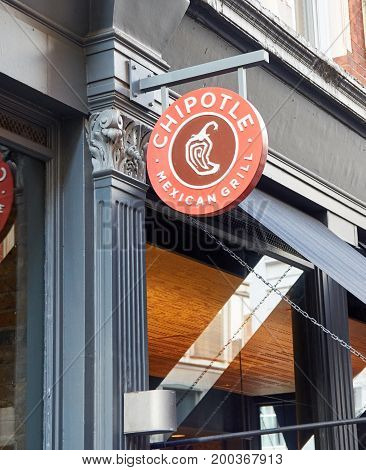 LONDON ENGLAND - MAY 13 2017 : Chipotle Mexican Grill signage. The company is an American chain of fast casual restaurants in the United States United Kingdom Canada Germany and France