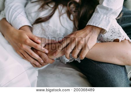 A Couple Holding Hands. Closeup