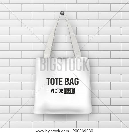 Realistic vector white textile tote bag. Closeup on brick wall background. Design template for branding, mockup. EPS10 illustration.