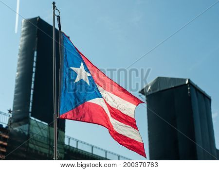Flag of Puerto Rico against the blue sky.