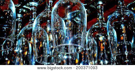Bar glasses hanging upside down inside a tavern.