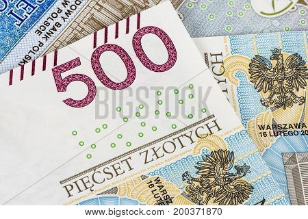 Closeup of 500 pln banknotes. Financial background