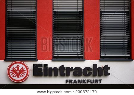 FRANKFURT, GERMANY - AUGUST 05: The coat of arms of the sports club Eintracht Frankfurt on the facade of a club building on August 05, 2017 in Frankfurt.
