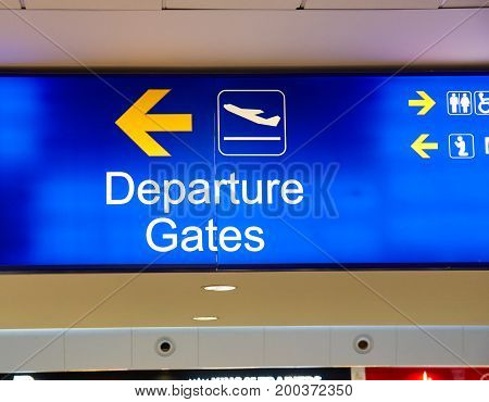 Departure gates signage and arrow sign in airport
