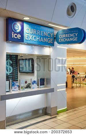 LONDON ENGLAND - MAY 14 2017 : ICE currency exchange office in airport. Intercontinental Exchange Inc. is an American network of exchanges and clearing houses for financial and commodity markets