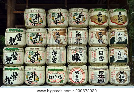 The drums or barrels of sake (Japanese alcoholic drinks) probably used as an offering in a temple. Pic was taken in Nara Japan July 2017.